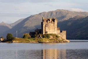 Eilean Donan castle, in the Scottish Highlands, seen at dusk.